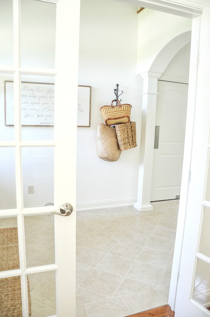 BASKETS ON A VERTICAL COAT RACK IN THE FOYER