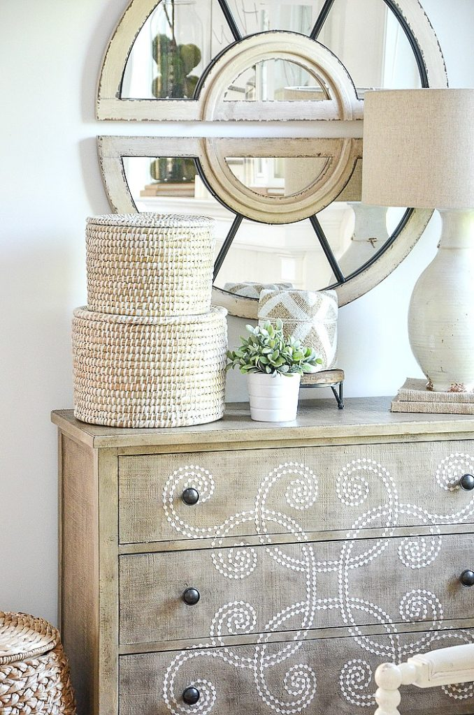 A CHEST WITH A MIRROR ABOVE IT on a summer home tour