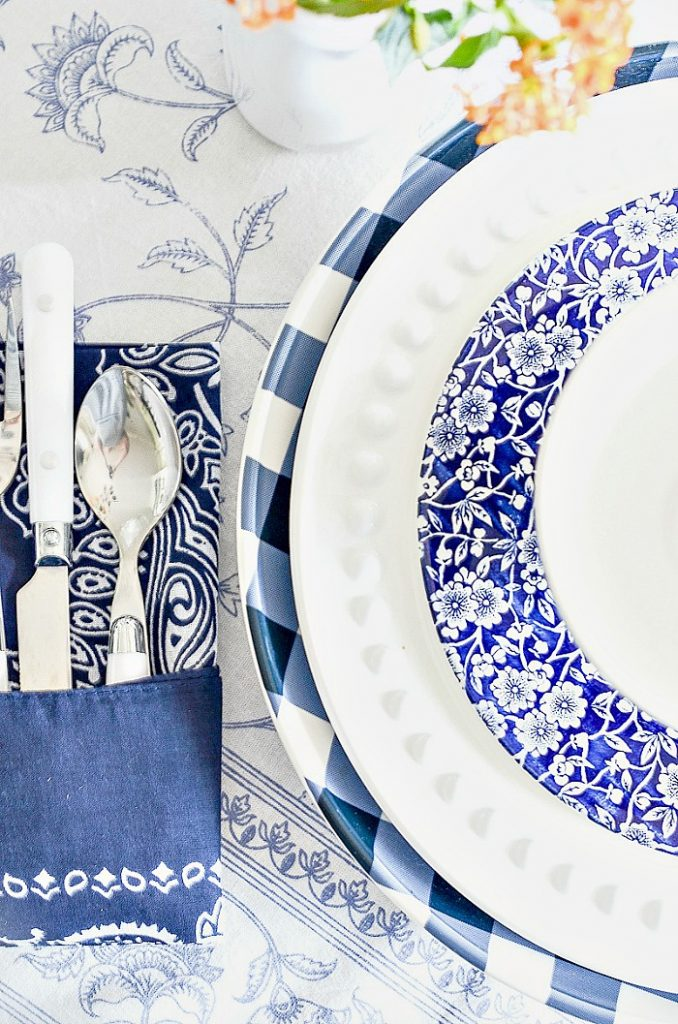 BLUE AND WHITE PLACE SETTING ON A SUMMER TABLE