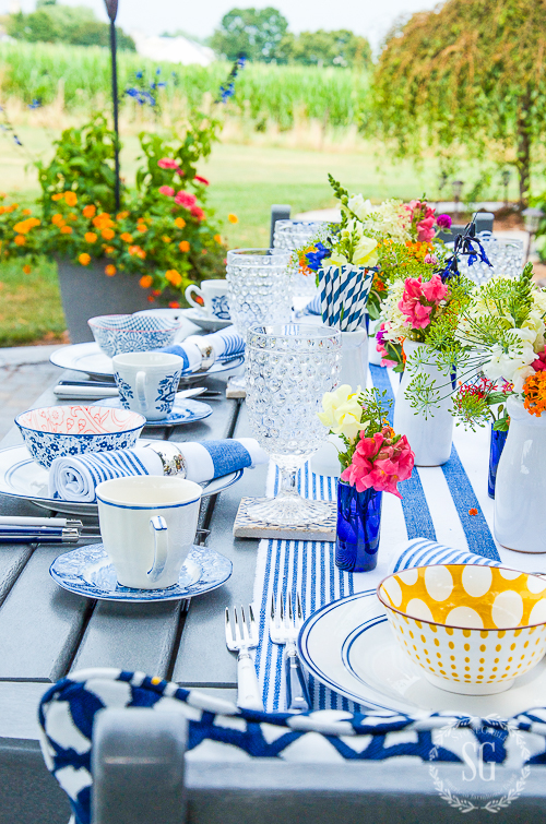 outdoor tables done in blue and white