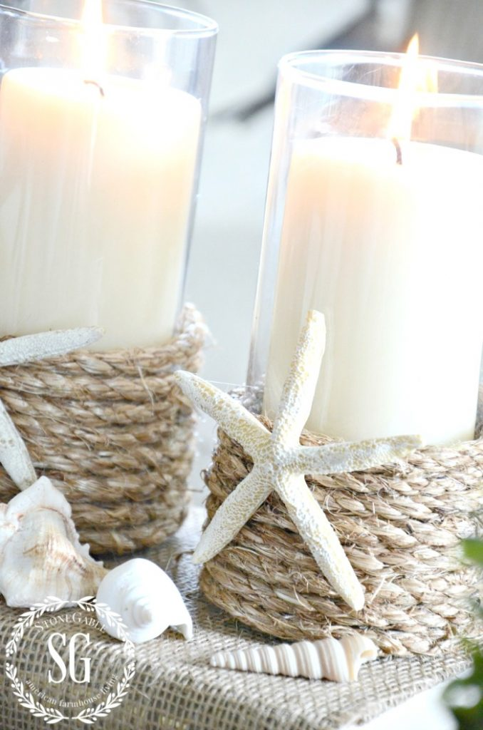 two roped wrapped candle holders with beach enbellishments