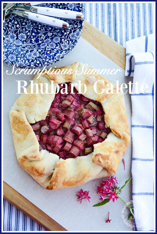 RHUBARB GALETTE ON A WORK SURFACE WITH BLUE AND WHITE PLATES
