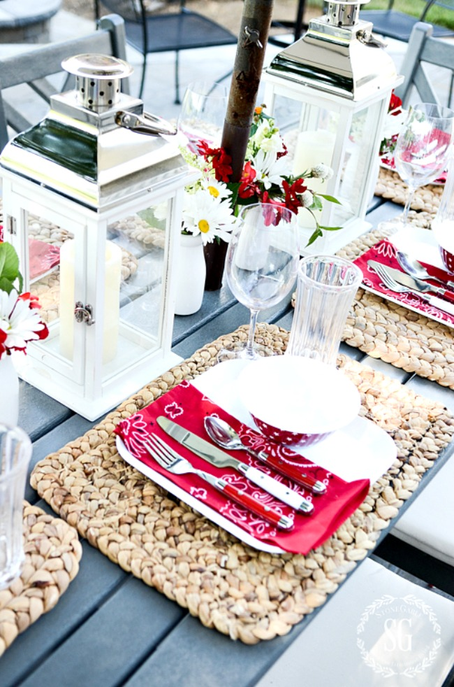 outdoor table with nubby placemats and plasticware