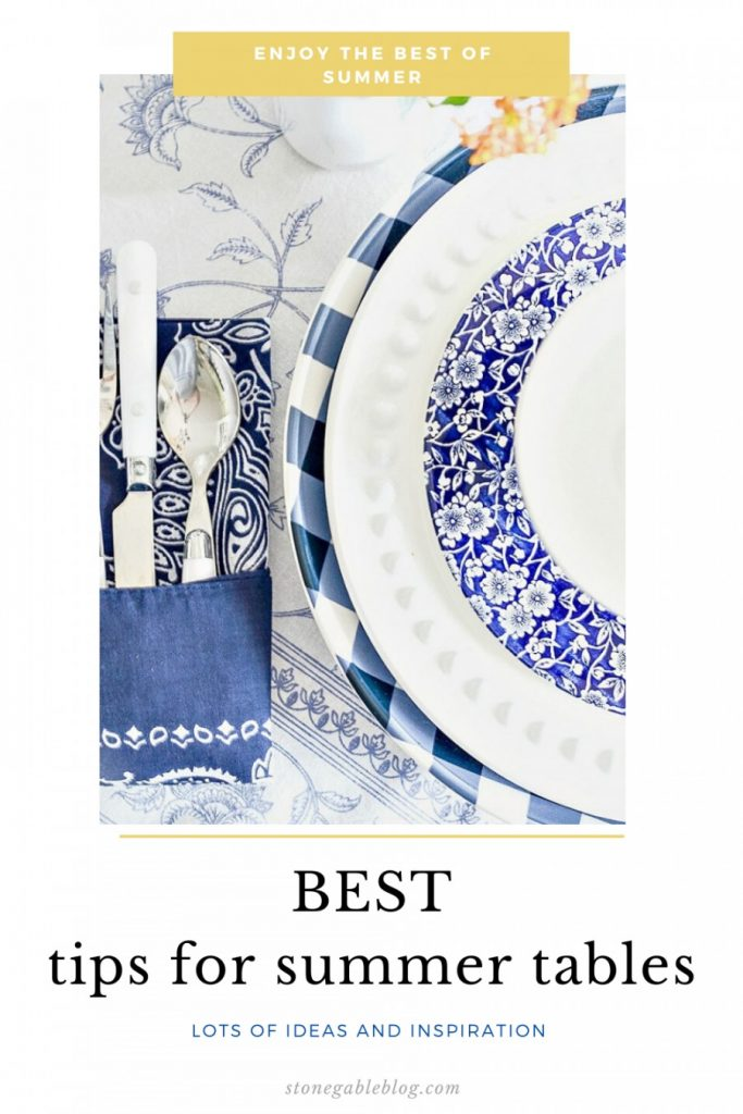 BLUE AND WHITE DISHES ON A TABLE WITH A BLUE AND WHITE TABLECLOTH