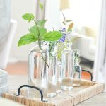 BOTTLE VASES WITH PRETTY SUMMER BLOOMS AND TWIGS