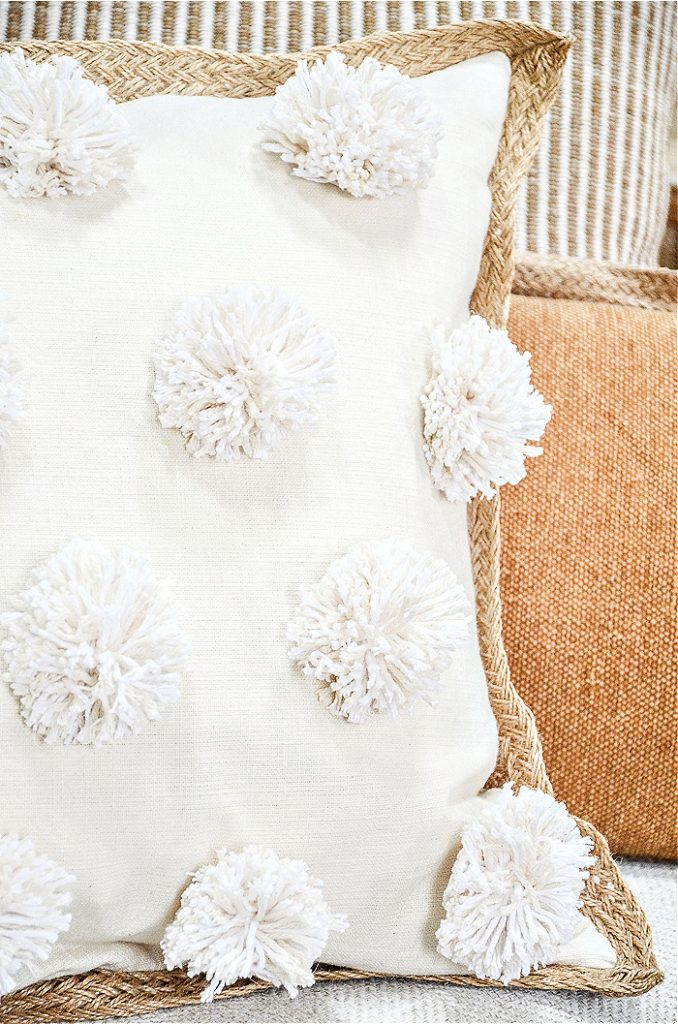close up of a pom-pom pillow