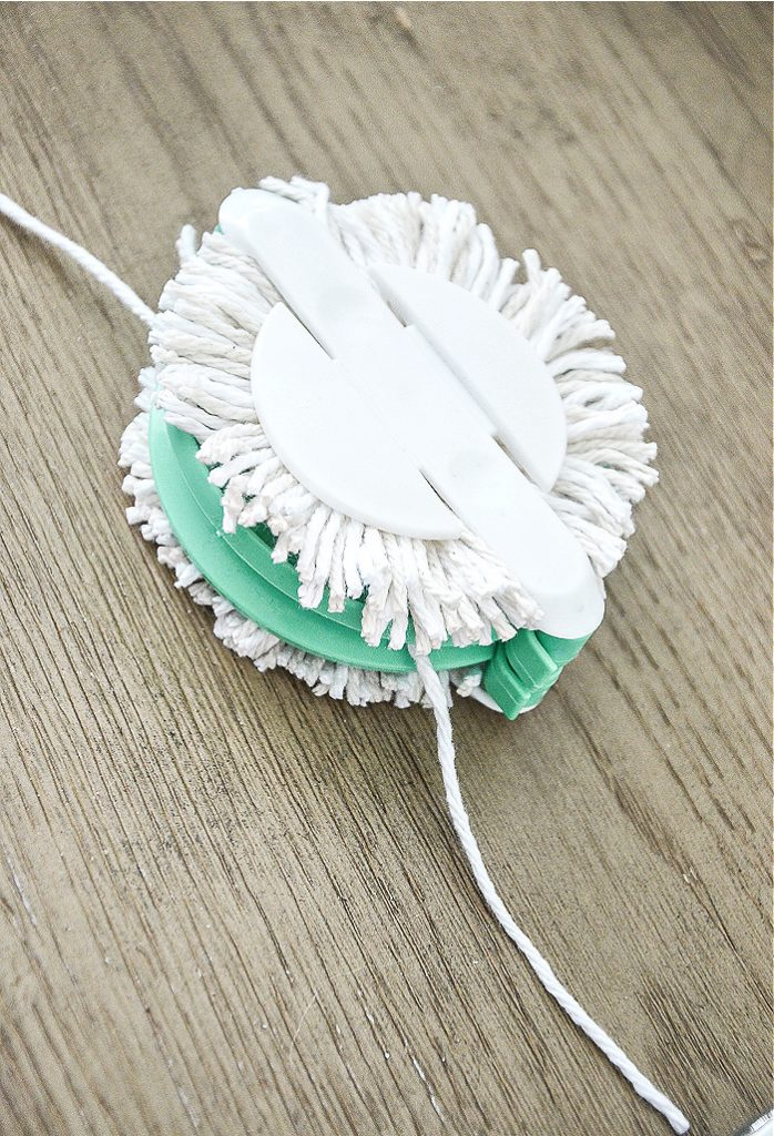pom pom maker with white yarn in it