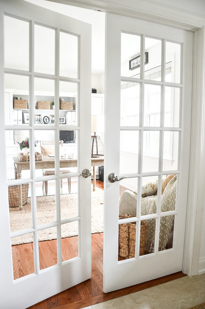 FRENCH DOORS THAT OPEN UP TO A PRETTY OFFICE TUCKED IN THE FRONT OF A HOME