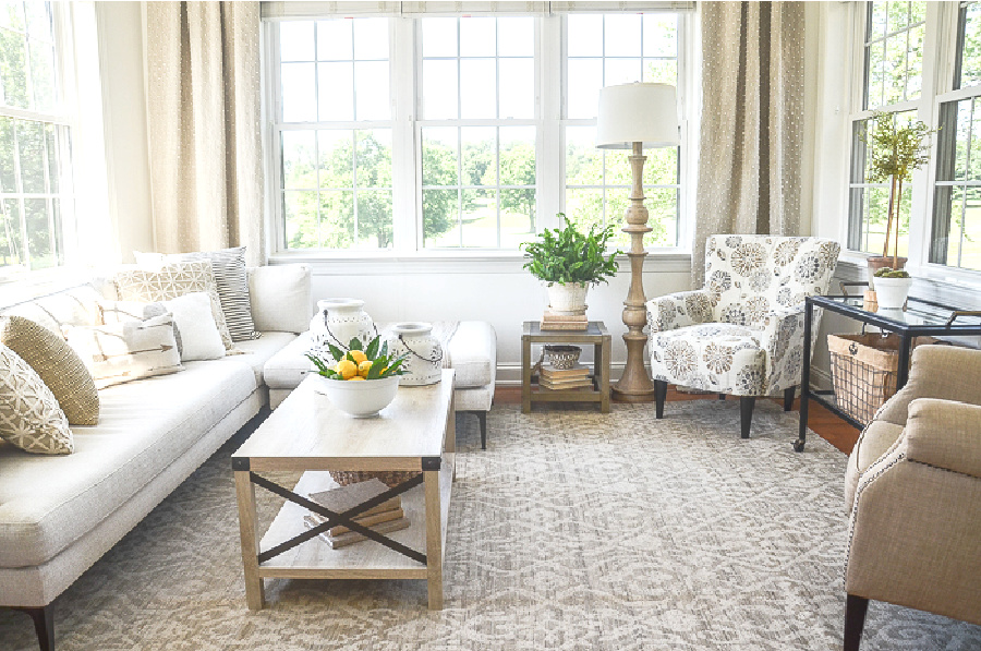 BEAUTIFUL NEUTRAL SUNROOM WITH A LONG WHITE SECTIONAL