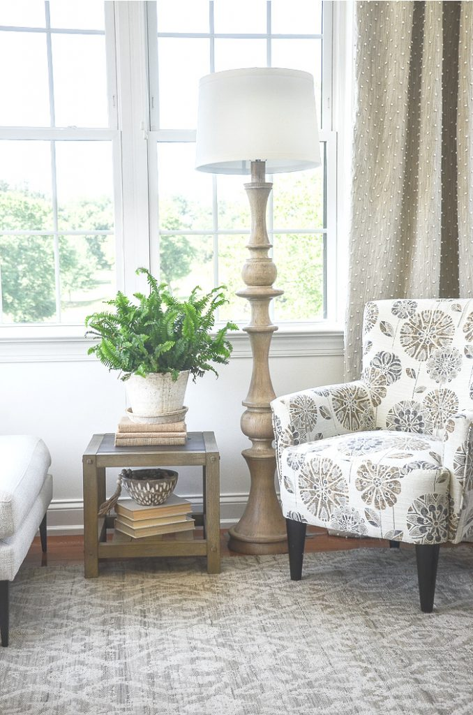 NEUTRAL SUN ROOM WITH A PRETTY STYLIZED FLORAL CHAIR ON TREND FOR 2021