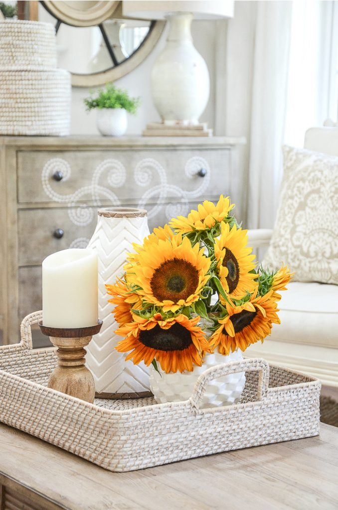 NEUTRAL ROOM WITH SUNFLOWERS THAT FLOWS INTO THE ROOMS AROUND IT