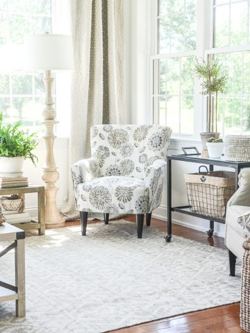 A styized floral chair in a sunroom