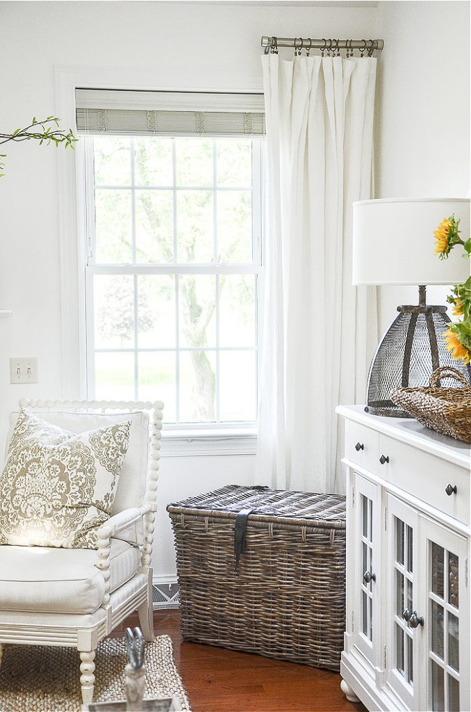 white linen curtains in a white painted great room