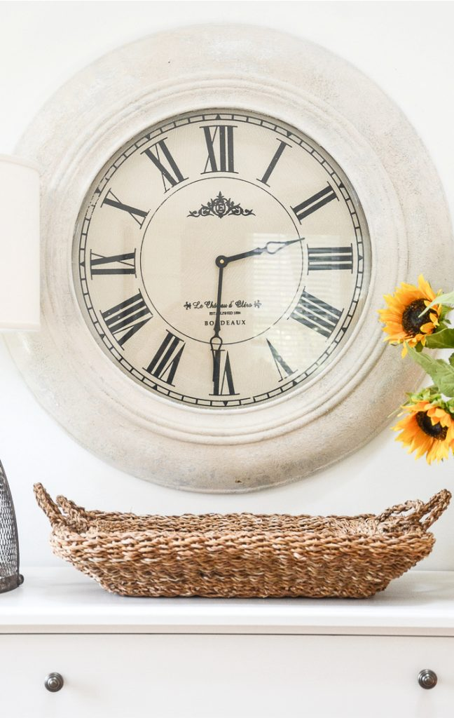 a wall clock that was painted white to give it new life.