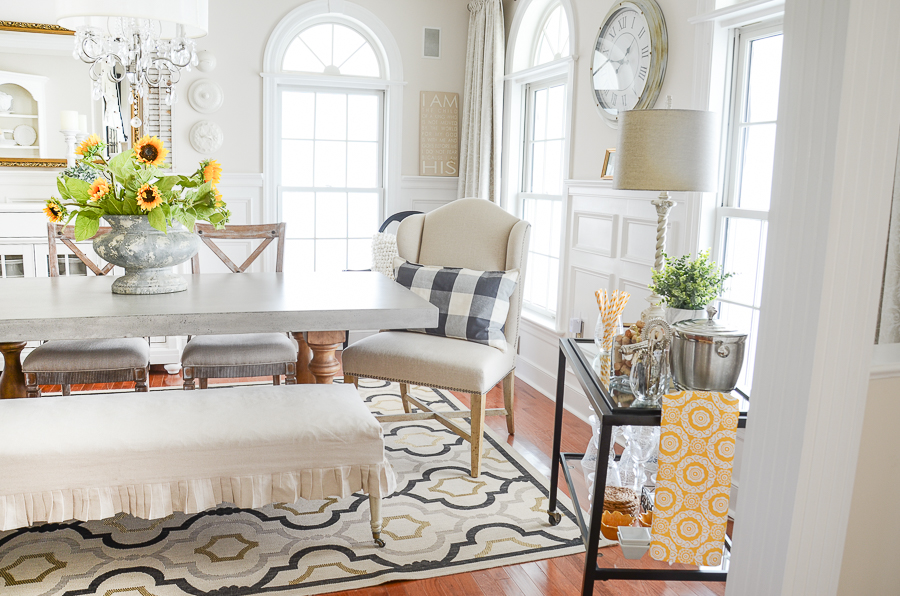 BEAUTIFUL CONCRETE TOPPED DINING TABLE IN A FORMAL DINING ROOM