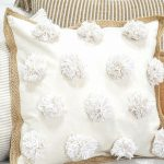 trio of pillows- pom-pom pillow is featured