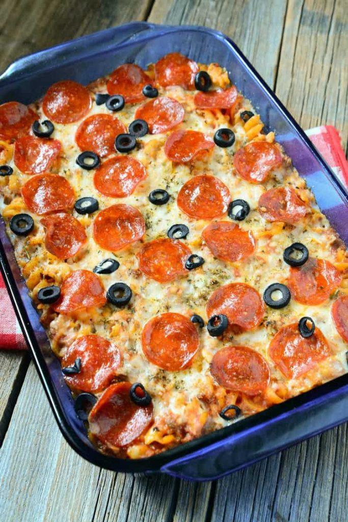 pizza casserole in a blue casserole dish
