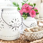 VIGNETTE WITH WHITE POTTERY AND PINK FLOWERS