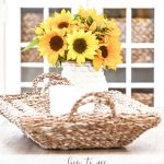 VASE OF SUNFLOWERS ON A COFFEE TABLE