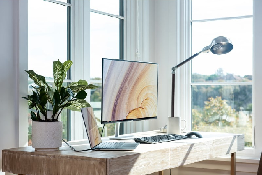 MODERN DESK WITH A COMPUTER ON IT