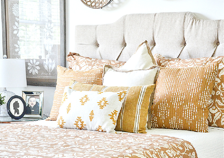 neutral upholstered headboard on a queen size bed