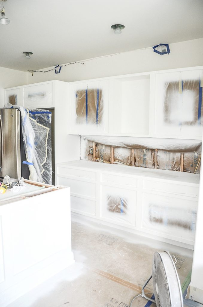 painting cabinets white in a kitchen renovation
