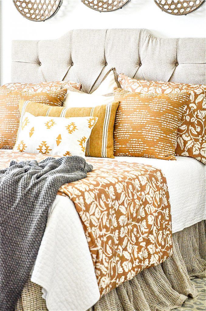 neutral upholstered headboard in a master bedroom