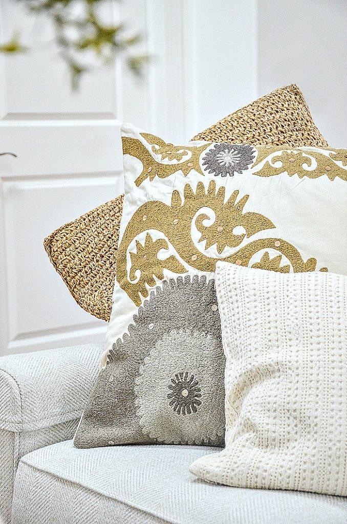pillows arranged on a sofa