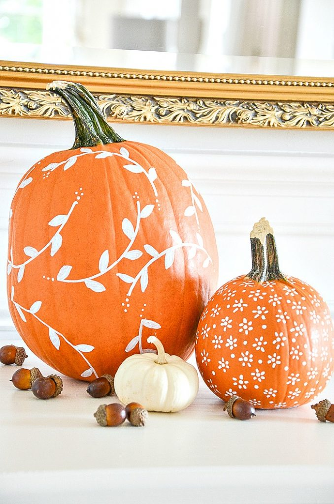 ORANGE PUMPKINS PAINTED WITH WHITE MOTIFS