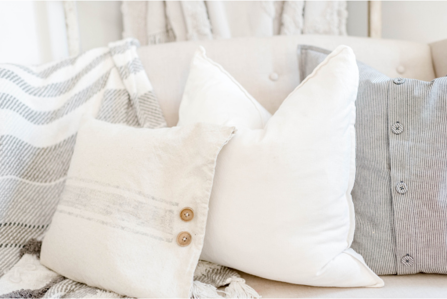 FARMHOUSE STYLE PILLOWS ON A SOFA