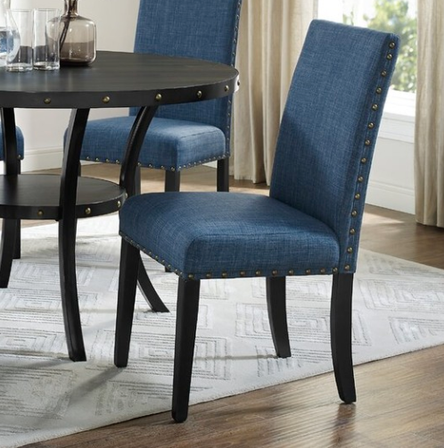 BLUE UPHOLSTERED CHAIRS AROUND A BLACK TABLE