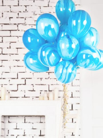 a bunch of blue baloons