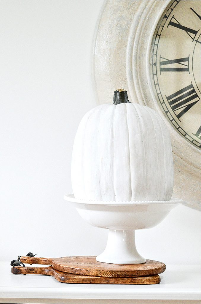 WHITE PEDESTAL BOWL WITH A WHITE PUMPKIN IN IT