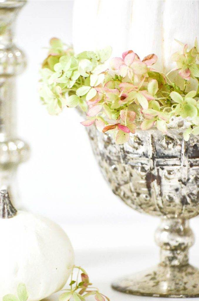 HYDRANGEAS IN A MERCURY GLASS PEDESTAL BOWL