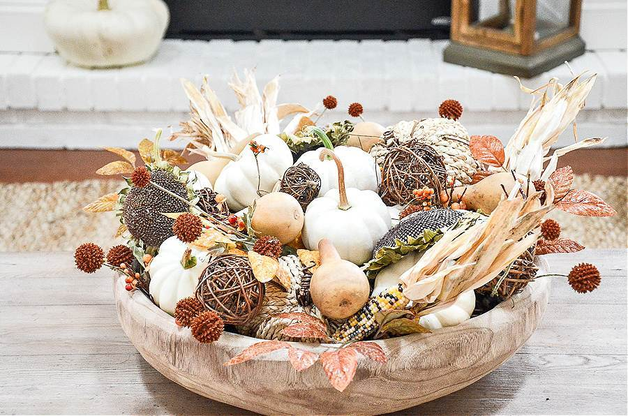 A DOUGH BOWL FILLED WITH NATURAL FALL ELEMENTS