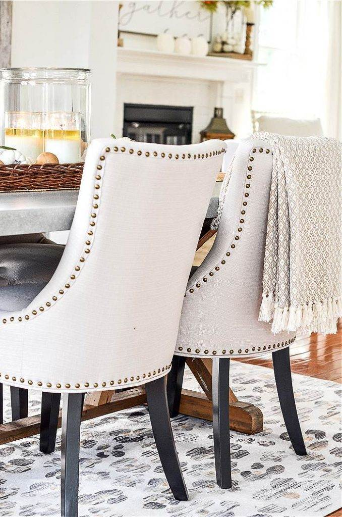 upholstered chairs around a dining room table