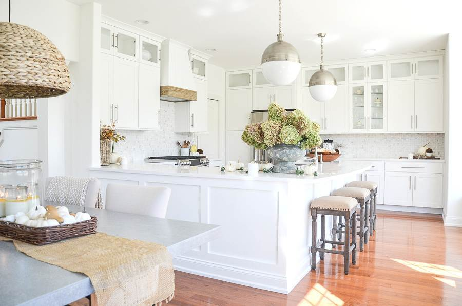 A WIDE VIEW OF A WHITE KITCHEN DECORATED FOR FALL