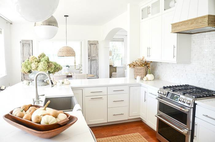 WIDE VIEW OF A WHITE KITCHEN DECORATED FOR FALL