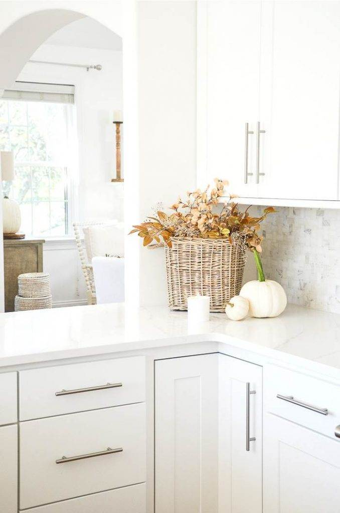 A BASKET OF FALL LEAVES IN A KITCHEN