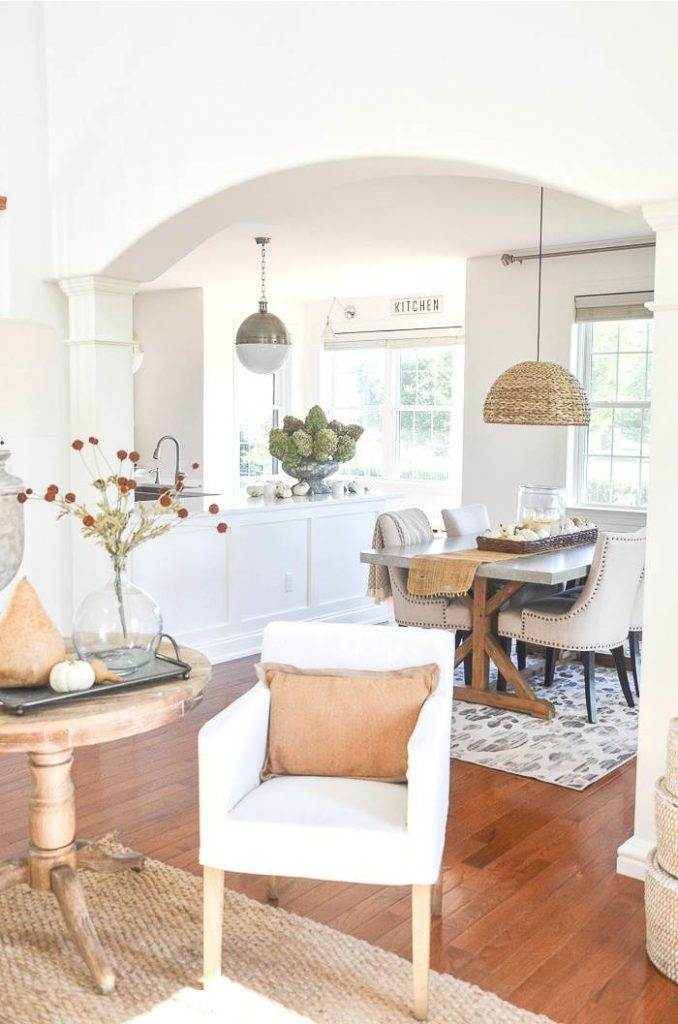 AN OPEN CONCEPT HOME LOOKING INTO THE KITCHEN FROM THE GREAT ROOM. DECORATED FOR FALL