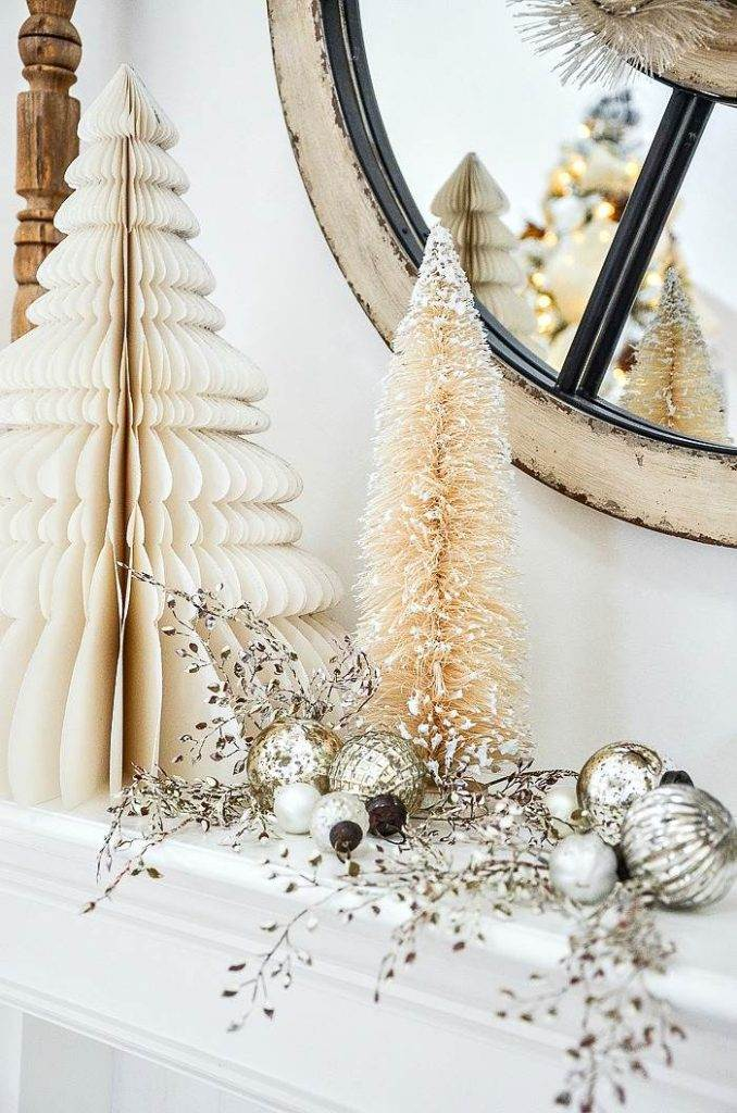 A MANTEL WITH WHITE CHRISTMAS TREES