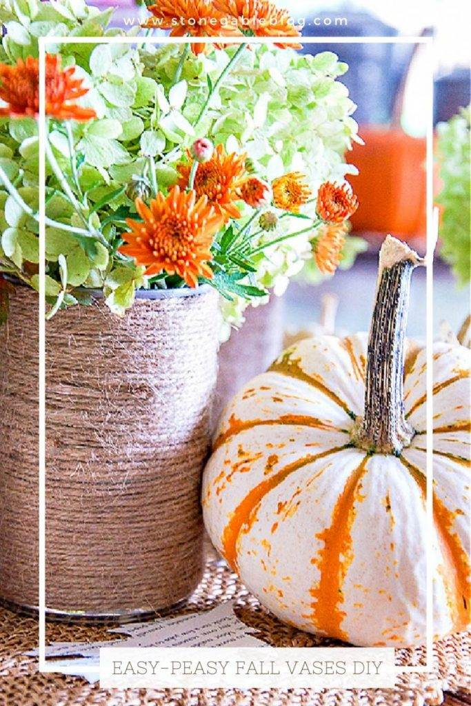 CLOSE UP OF A TWINE WRAPPED VASE AND A PUMPKIN