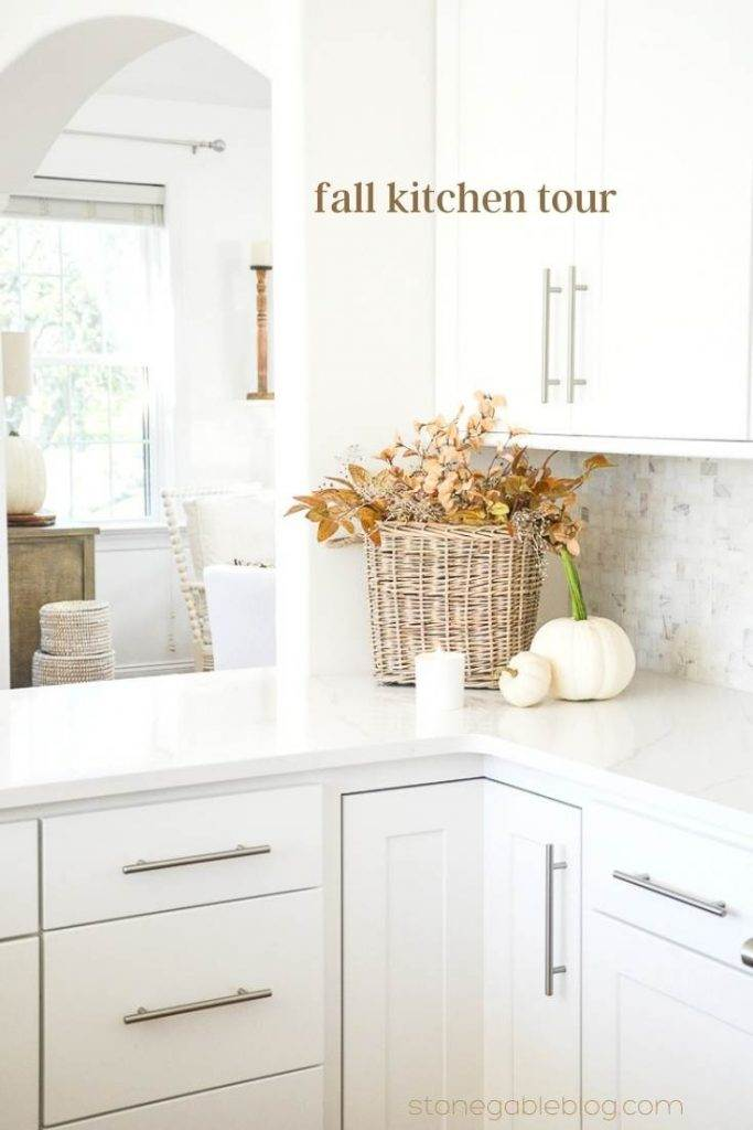 basket and pumpkins in the corner of a kitchen