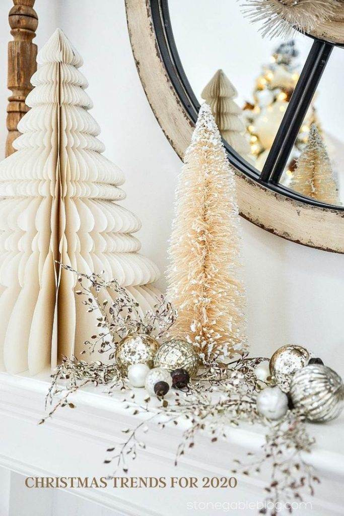 white trees on a mantel with silver ornaments