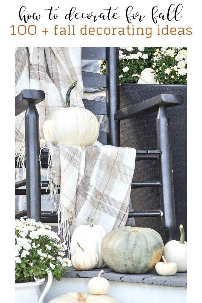 ROCKER ON THE PORCH WITH WHITE PUMPKINS, A THROW AND MUMS