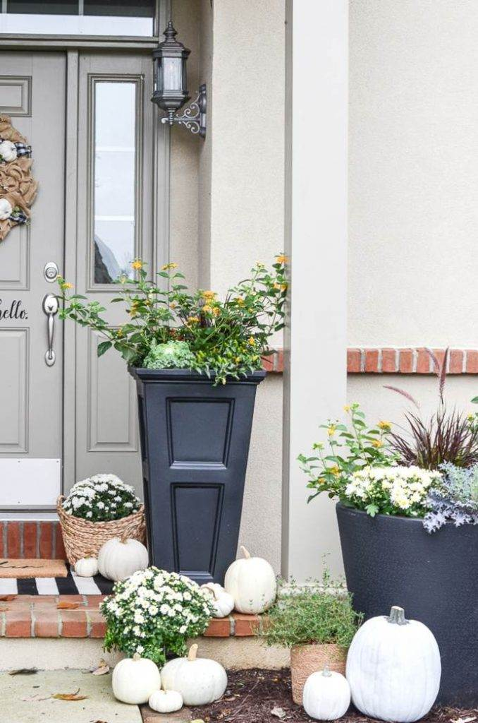 FALL FRONT PORCH WITH PLANTERS AND PUMPKINS