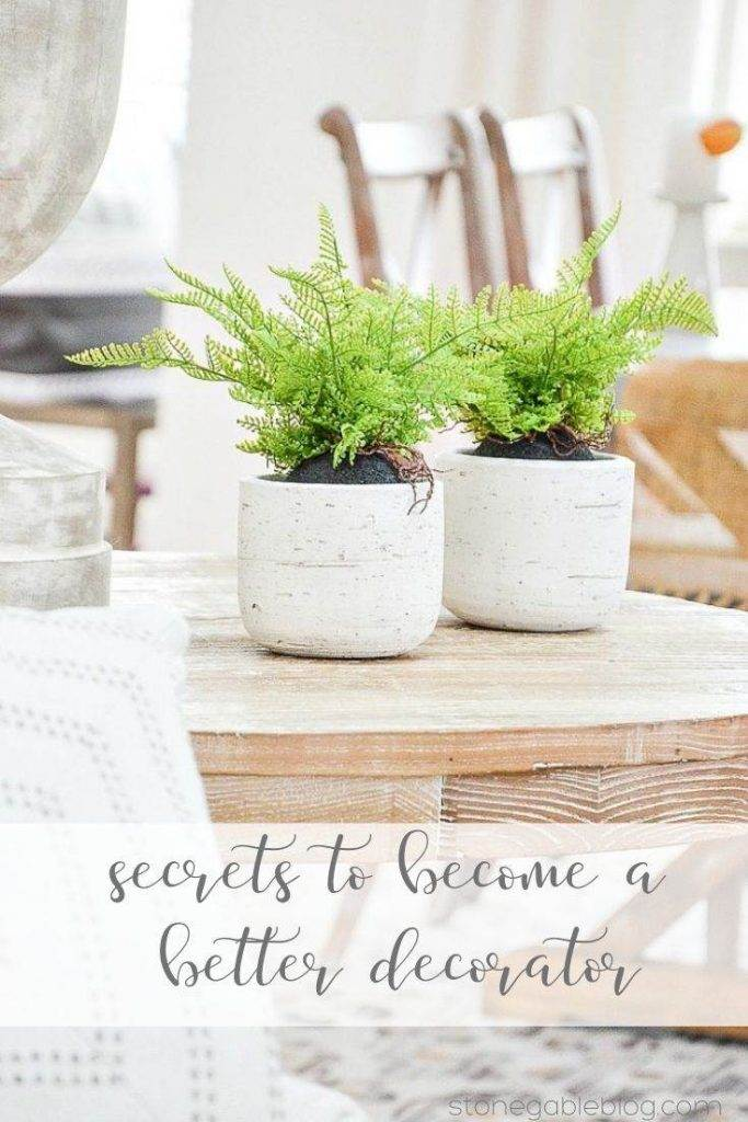 TABLE WITH FERNS IN WHITE POTS ON IT