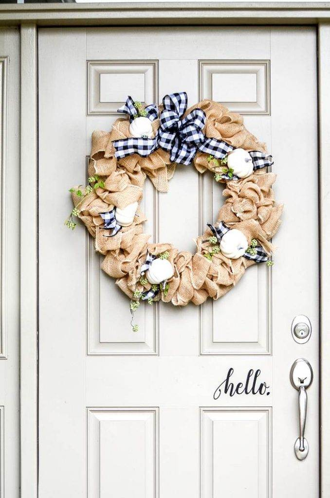 FRONT DOOR WITH A FALLWREATH ON IT