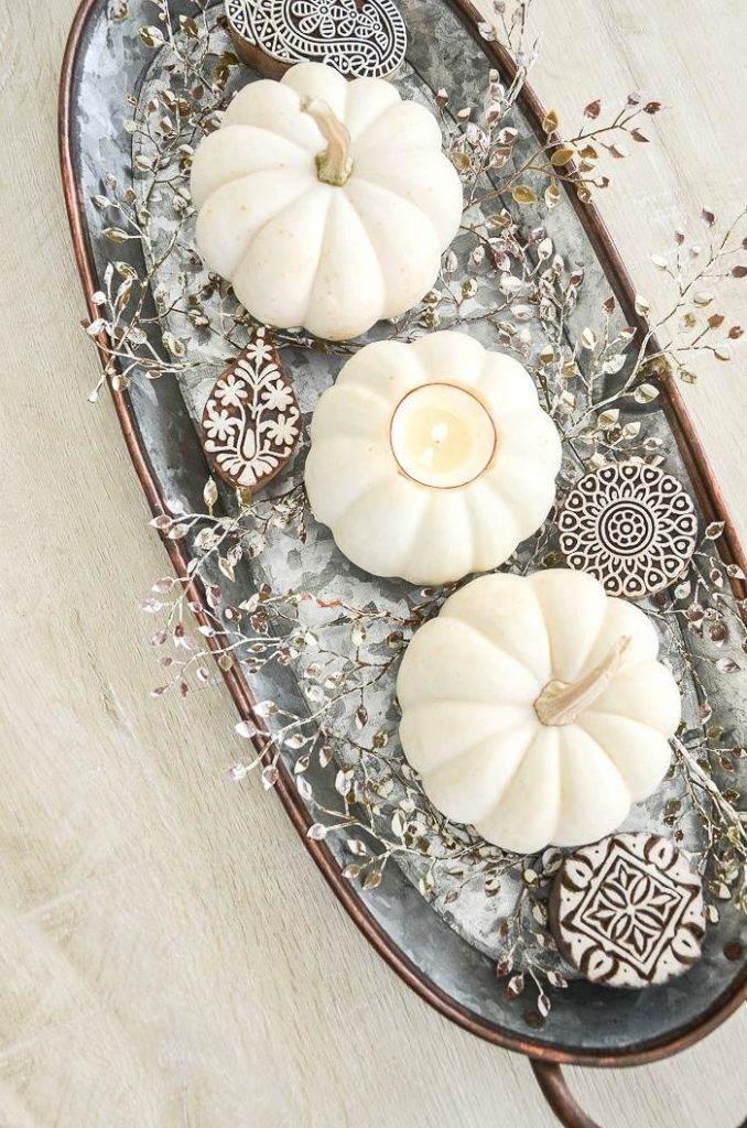 WHITE PUMPKIN WITH CANDLE IN IT