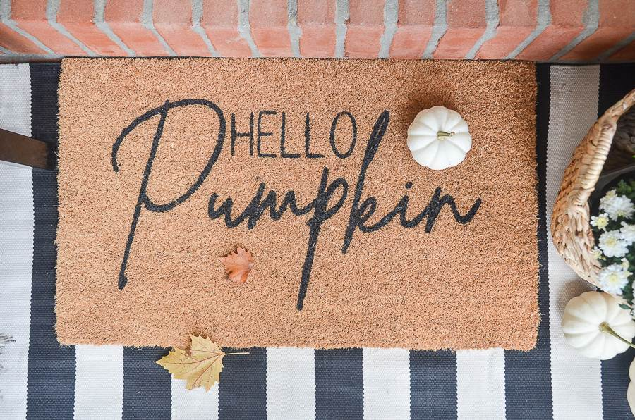 "A FALL DOORMAT SAYING ""HELLO, PUMPKIN"""
